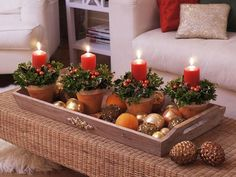 Christmas Candle Decorations. Tray with teracotta pots, ornaments, holly, and PartyLite pillars! Follow at: www.partylite.biz/jenhardy www.facebook.com/partyhardyjen #jenhardyyourcandlelady