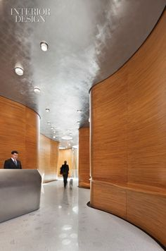 Metallic ceiling + curved wood walls