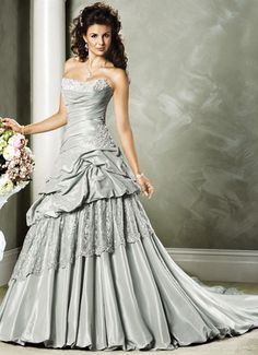 Google Image Result for http://media10.onsugar.com/files/2011/08/32/3/1852/18524036/ab8359fa31a37b84_silver_wedding_dresses_C.jpg