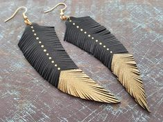 Leather feather earrings. Feather earrings. Leather earrings. Boho earrings. Bohemian earrings. Tribal earrings. Hippie earrings. Boho chic. Feather jewelry. Boho jewelry. Materials: leather,gold plated metal. Colour: black,gold. Full length with hooks: 11 cm(4.33) If you have any
