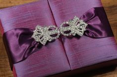 Purple Dipioni silk box, couture invitation collection, embellished with rhinestone crystal buckle. Beautiful finish for weddings or any special occasion.