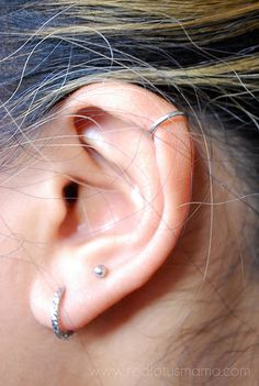 ear piercing love the cartilage piercing on top and the smaller stud in the middle! Unique.