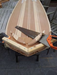 an overview of a wooden surfboard being built from start to finish