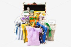 Qdiz Stock Photos   Decorative textile sachet pouches,  #background #bag #bow #box #burlap #cloth #container #craft #decoration #decorative #fabric #filled #gift #handmade #homemade #isolated #material #package #packaging #packet #poke #pouch #present #ribbon #sac #sachet #sack #small #sparse #textile #white