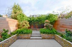 We designed this Chiswick garden to be simple and low maintenance. The boundaries were made more attractive and 2 distinct areas created.