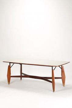 Melchiorre Bega; Mahogany, Brass and Crystal Glass Dining Table for Altamira, 1960s.