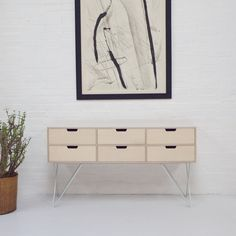 Stand 50. Leonard Sideboard in Pale Grey. Pale grey powder coated steel legs, hand built plywood body with six drawers and a graphic Formica top. www.andnew.co.uk