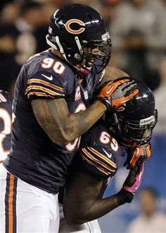 Chicago Bears defensive end Julius Peppers (90) celebrates his sack of Detroit Lions quarterback Matthew Stafford with defensive tackle Henry Melton (69) in the first half of an NFL football game in Chicago, Monday, Oct. 22, 2012. (AP Photo/Nam Y. Huh)