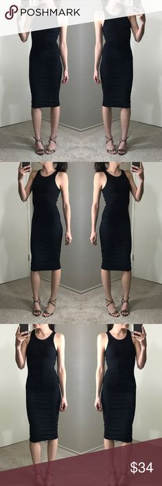 "Black Fitted Racerback Bodycon Dress A perfect fitted lighter weight little black dress that is bra friendly and a true fit for every occasion. Throw a blazer or cardigan over for work or dress up for a night out 🖤 95% cotton 5% spandex. Dress has a lot of stretch and is not see through. Measurements • Small: 42"" length 14"" pit to pit 15"" waist • Medium: 42.5"" length 14.5"" pit to pit 16"" waist • Large: 43.5"" length 15.5"" pit to pit 17"" waist. Modeling: SMALL. Please purchase directly…"