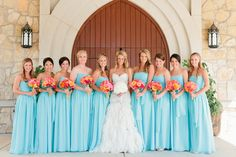 Blue Bridesmaids with bright flowers