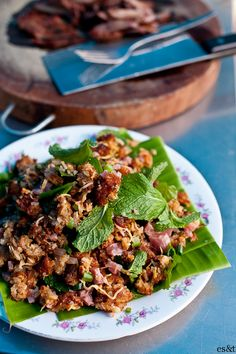 Nhem Khao, Laotian crisp rice salad lovee this dish with lettuce and rice. Learn how to prepare similar traditional meals on a Laotian Cooking class from Viator. Find out more at: http://www.allaboutcuisines.com/cooking-school-classes/laos/in/laos #Laotian Food #Laotian Cooking Classes. #Cooking Schools Laos