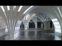 Penda adds arching columns designed to resemble dandelion seeds to a Beijing shop - YouTube