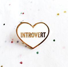 Introvert heart hard enamel lapel pin. Smooth white hard enamel with gold trim…