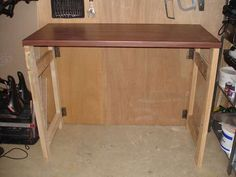 pretty easy to do table: http://www.instructables.com/id/Make-a-fold-down-workbench/