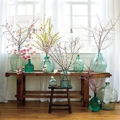 A wedding inspired this spring look. Simple colored glass bottles filled with twigs. Can do the blue dye for glass thing. Spring Branch, Sweet Home, Sweet Sweet, Deco Floral, Floral Design, Design Design, Vintage Bottles, Vintage Wine, Spring Home