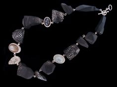Susan Chin, Rudolph, 2016, necklace, ebony with sterling silver inlay, faceted gray moonstone, chocolate and white moonstone, quartz, 457 mm long, plus 25-mm extension links, photo: Andrea Marx White Moonstone, Jewelry Art, Jewellery, Beautiful Necklaces, Quartz, Pendants, Pendant Necklace, Jewels, Sterling Silver