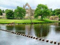 Bolton Abbey in the Yorkshire Dales, near Skipton. We LOVED this place and came here several times. I have a cute pic of my oldest son, when he was two, tucked into a niche on the back wall of the ruin. It's so beautiful. And the little stones across the river are a fun challenge to walk cross.