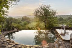 The view from one of the two main lodge swimming pools at Singita Faru Faru The Great Migration, River Lodge, Out Of Africa, African Safari, Tanzania, Lodges, Luxury Travel, Adventure Travel, Swimming Pools