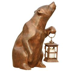 I pinned this Bear Statue with Lantern from the SPI Home event at Joss and Main!