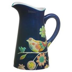 "Ceramic pitcher with a multicolor bird and floral motif.  Product: PitcherConstruction Material: CeramicColor: Navy, green, orange and yellowFeatures:  One handleHand-painted30 ounce capacityDimensions: 11"" H x 9"" W x 6"" D"