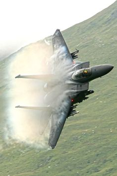 A USAF McDonnell-Douglas F-15 Strike Eagle turns and burns, leaving a vapor trail as it pulls G's in its turn.