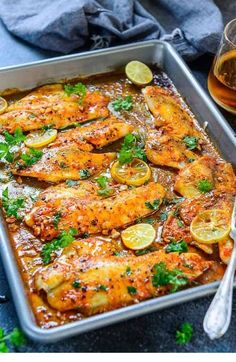 Healthy Meals baked tilapia o a baking tray along with a glass of wine - This Spicy Lemon Garlic Baked Tilapia takes all of 5 minute of preparation time before you pop it in the oven. Baked Tilapia Fillets, Tilapia Fillet Recipe, Halibut And Rice Recipe, Lemon Pepper Tilapia Baked, Basa Fillet Recipes, Best Tilapia Recipe, Redfish Recipes, Oven Baked Tilapia, Healthy Eating Recipes