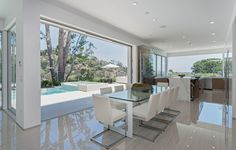 Enjoy this open space dining area that is connected to the kitchen and features wrap around views  and access to the pool and spa. 318 Bellino Drive | Pacific Palisades