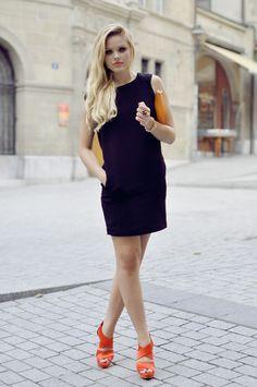 black dress with orange sandals