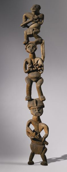 Africa | Figural Palace Column from the Bamileke people of the Grassfields of Cameroon  | ca. 1963 or earlier. | Houseposts such as this one supported the roof of an open veranda attached to the Chief's residence, the centre of the chiefdom.  This was a traditional building of raffia palmrib construction looking upon the chiefdom's main market, the major point of trade transactions for the economic welfare of the chiefdom.