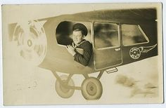 Vintage arcade photo - sailor in a painted aeroplane