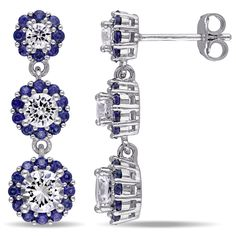 These charming dangle earrings from the Miadora Collection feature three round-cut created white sapphires. Each white sapphire is surrounded by a halo of created blue sapphires. This lovely pair is set in sterling silver.