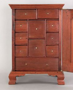 """Pook & Pook.  6/20/09. Lot 433. Estimated: $8K - $12K. Realized: $8775.  PA. Chippendale carved walnut spice chest, ca. 1770, with a deeply molded top above a single cupboard door with a rectangular paneled front opening to an arrangement of small drawers, the molded base continuing to ogee bracket feet, 24 1/4"""" h., 16 3/4"""" w."""