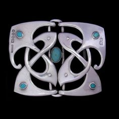 This is not contemporary - image from a gallery of vintage and/or antique objects. MURRLE BENNETT & Co. (1886-1914)  A silver Murrle Bennett & Co. buckle set with turquoise cabochon stones.