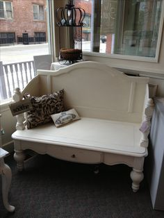 RePurposed bench. This piece is made from a coffee table and 2 headboards.