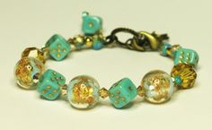 Dice Bracelet Pale Blue and Gold Free US Shipping. $30.00, via Etsy.