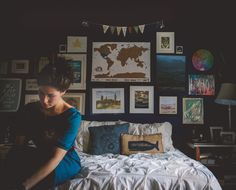 Create a wall of artifacts from travels to create a individualized bedroom.