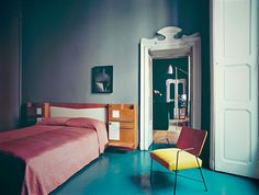 Appartement  of Emiliano Salci from Dimore Studio. | Bedroom with solid wood full-height panel shutters.