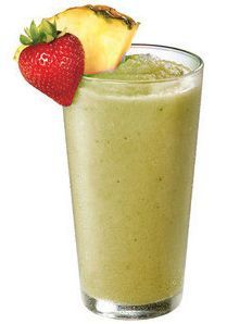 Aloe Vera Smoothie Beverage in a tall glass garnished with fruit