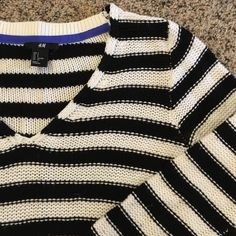 H&M sweater Black and white striped v-neck sweater from H&M. Very cozy and worn only a few times. H&M Sweaters V-Necks
