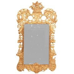 18th Century Irish Carved Giltwood Mirror | From a unique collection of antique and modern wall mirrors at https://www.1stdibs.com/furniture/mirrors/wall-mirrors/