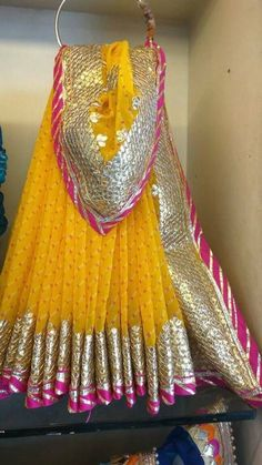 Traditional Leheriya Georgette Saree with Gota Patti work. Comes with Blouse piece Bridal Mehndi Dresses, Mehendi Outfits, Pakistani Wedding Outfits, Bridal Outfits, Indian Outfits, Indian Dresses, Shadi Dresses, Indian Clothes, African Dress