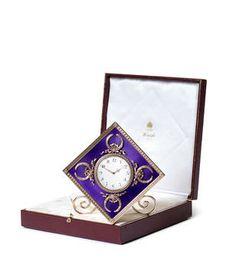 An enamelled silver-gilt desk clock by Fabergé, workmaster Michael Perchin, St…