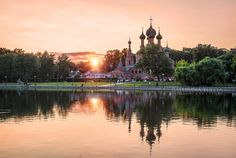 sunset minimalism - No clouds Sunset over the temple in Ostankino in Moscow