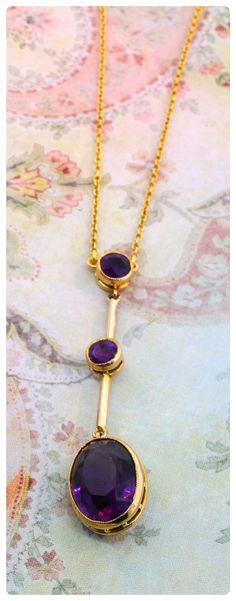 Talk about sultry!  This 14K yellow gold necklace features three swanky drops of faceted amethyst in gold bezels.  Will rest snuggly about your collarbone at 16 inches.