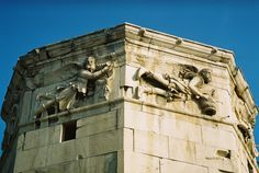 Detail of the frieze on the Tower of the Winds. Shown are the Greek wind gods Boreas (north wind, on the left) and Skiron (northwesterly wind, on the right).
