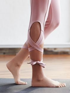 Turnout Leggings | Ideal for dance, these luxury performance leggings are American made from our premium Italian-sourced tech fabric. Our Perfect Form Blend provides two-way stretch, UV protection, and superior breathability. Get wrapped up in your workouts with the Picot Perfomance wrap ties, designed to form keyholes along the calf. These versatile ties can be laced any which way you choose. Surplice waistband and 360 degree Performance Seaming. *By FP Movement *One of 9 exclusive, in-...