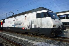 Switzerland SBB Re 460 with full body advertsiment for an insurance company.