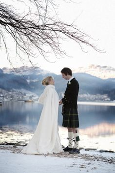Romantic wedding by the lochside in the snow Scotland. Romantic winter wedding in Scotland.