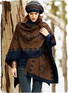 Adore. Geometrics from a traditional Navajo blanket make a cozy statement. Knit of softest baby alpaca, the reversible pattern alternates heathered navy and maple brown.