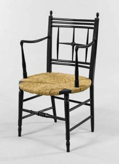 An ebonised 'Sussex' armchair designed by Ford Maddox Brown, made by Morris & Co, re-rushed, circa 1875. 89 cm (35 in) high.